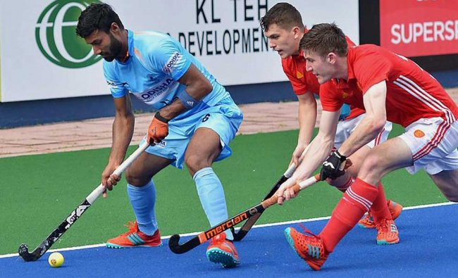 Indian and England hockey players during Sultan Azlan Shah Cup 2018, at Ipoh in Malaysia on Sunday.