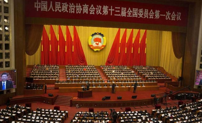 Chinese President Xi Jinping is seen a large screens at the opening session of the Chinese ...