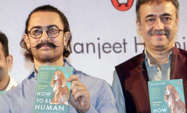 Bollywood actor Aamir Khan with Rajkumar Hirani at a book launch titled \'How to be Human: Life ...