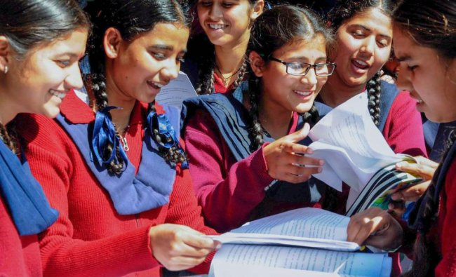 Students discuss the question paper after appearing in the 12th standard exam of CBSE board, in ...