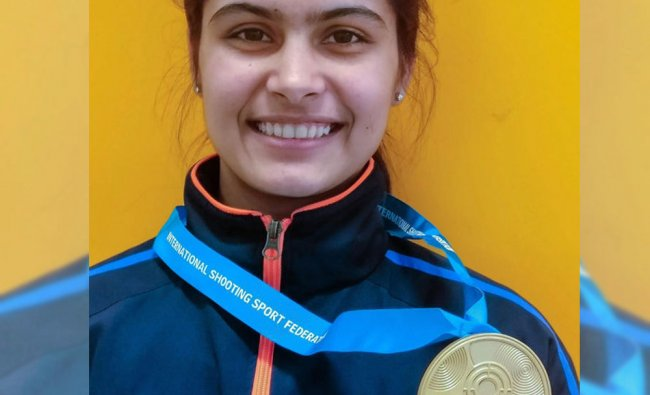 Indian shooter Manu Bhaker poses for photographs after winning gold in womens 10m air pistol ...