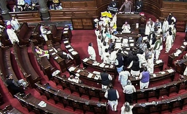 Opposition members protest during the ongoing budget session of Parliament in the Rajya Sabha, in ..