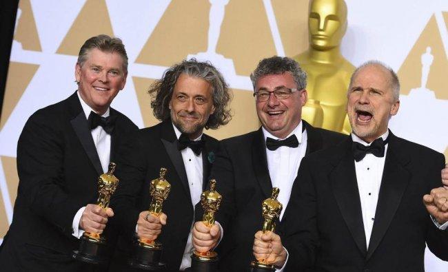 chard R. Hoover, from left, Paul Lambert, Gerd Nefzer, and John Nelson, winners o the award for ...