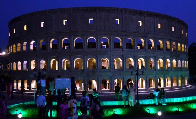 Peoples enjoying to see enlighted Replica buildings of the colosseum of rome of Seven Wonders in...