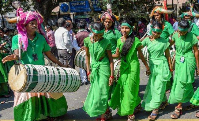 Tribal members of Andhra Pradesh and Telangana hold a demonstration for fulfilment of various...