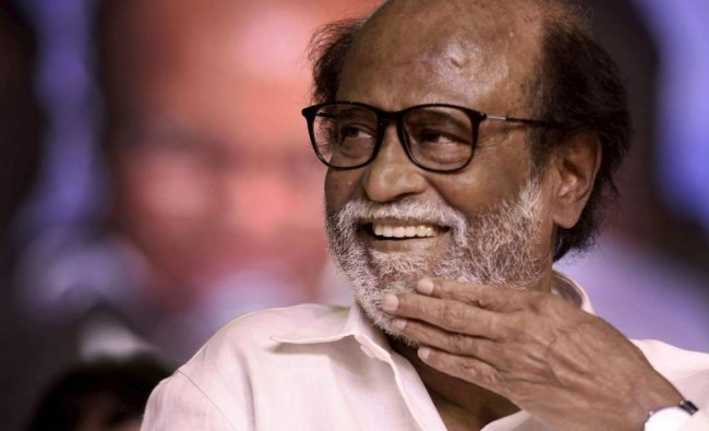 Tamil actor Rajinikanth gestures at an event where he unveiled a statue of former Tamil Nadu...