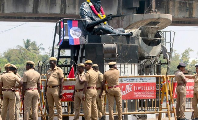 Police personnel guard the statue of rationalist leader E V Ramasamy, popularly known as \'Periyar...