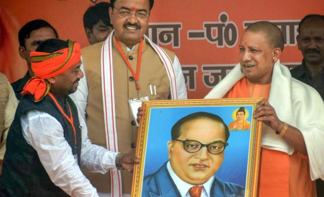 UP Chief Minister Yogi Aditya Nath being presented a portrait of Dr BR Ambedkar during an election..
