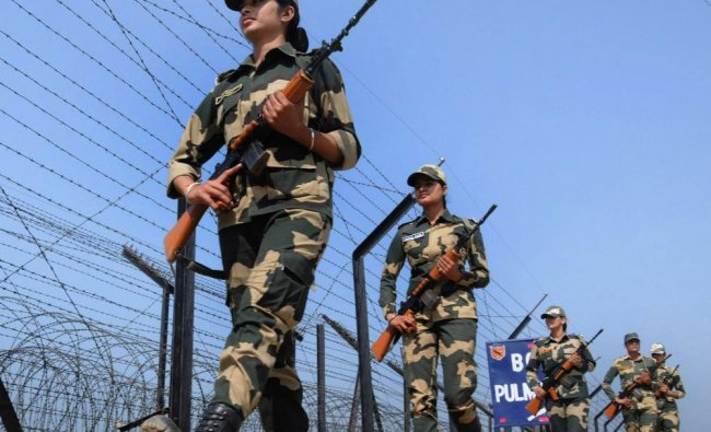 Border Security Force\'s (BSF) women soldiers patrol near the barbed fence at the India-Pakistan...