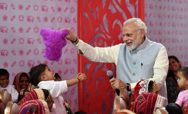 Prime Minister Narendra Modi interacts with the \'Beti Bachao Beti Padhao\' beneficiaries, on the occa