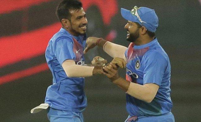 India\'s Yuzvendra Chahal, left, and Suresh Raina celebrate the dismissal of Bangladeshi batsman...