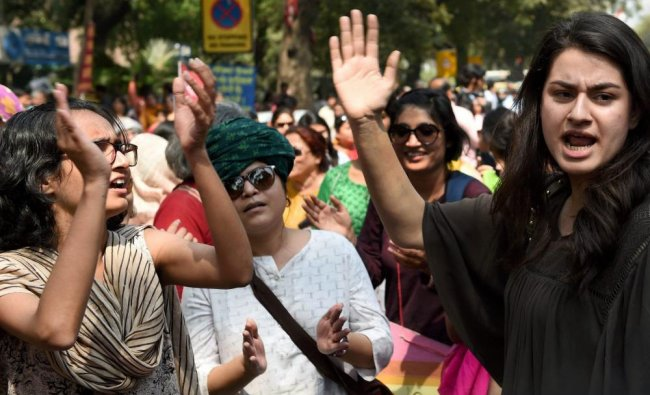 Women activists raise slogans as they take part in an International Women\'s Day rally at Jantar...