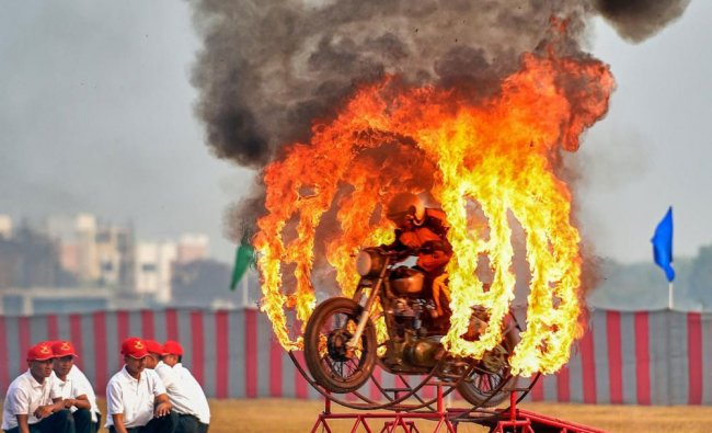 An Indian army cadet of the Officer Training Academy performs a daredevil stunt during...