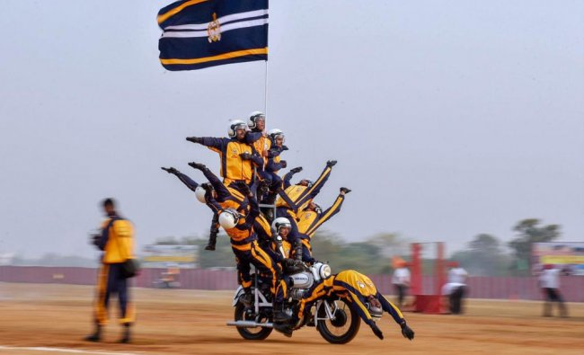 An Indian army cadets of the Officer Training Academy perform a daredevil bike stunt during...