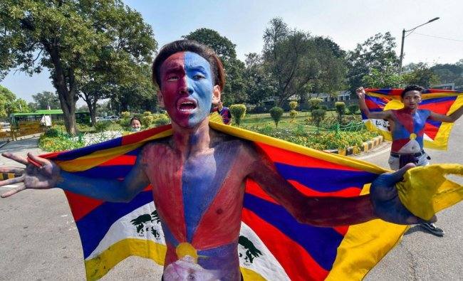 A member of Tibetan community shout slogans during a protest to mark the 59th anniversary...