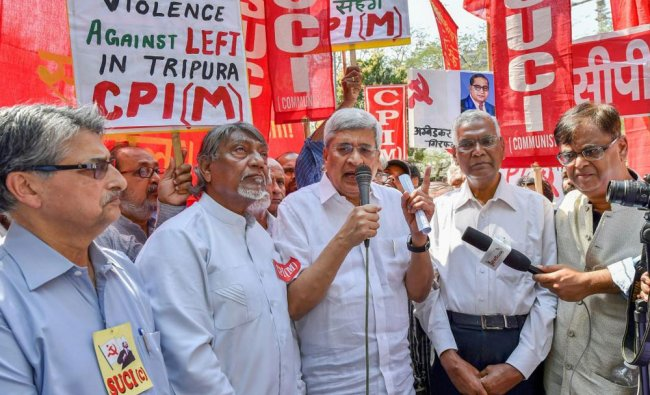 Members of the leftist party address the media during a protest against the demolition...