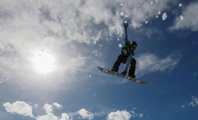 An athlete soars during Gorilla Winter Jungle snowboarding and freestyle skiing festival...