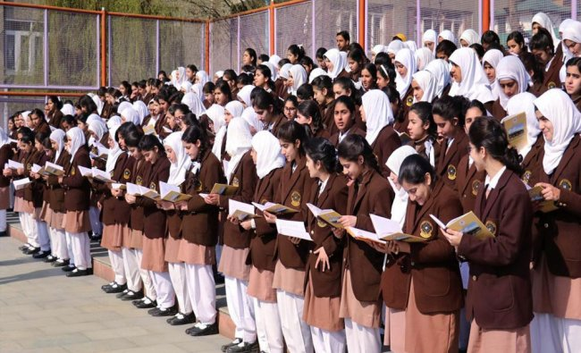 School students attending morning assembly as schools and colleges open after the closure...