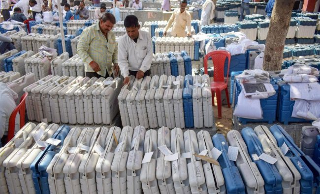 Polling and Presiding officers collect Electronic Voting Machine (EVM) and Voter Verifiable...