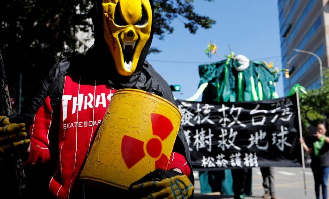 Demonstrators take part in a protest against nuclear power on the 7th anniversary of Japan\'s...