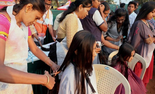 Students donate their hair to help people affected by cancer during Mega Marathon...