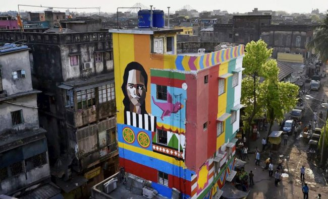 A house painted by an NGO during a beautification drive at a red-light...