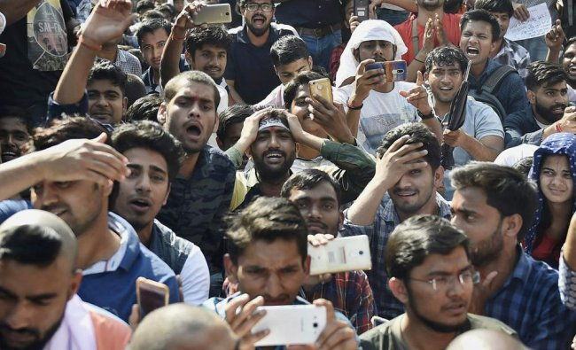 Staff Selection Commission (SSC) candidates raise slogans in protest against alleged paper...