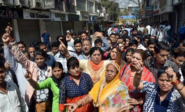 Traders of shops at Amar Colony protest against sealing drive...