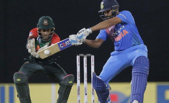 India\'s Rohit Sharma plays a shot against Bangladesh as Mushfiqur Rahim watches during...