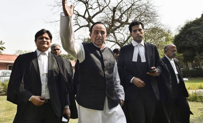 BJP senior leader Subramanian Swamy leaves after appearing at Supreme Court in connection...