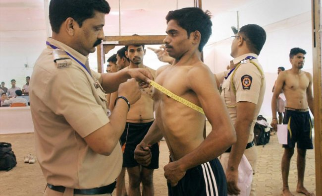 Maharashtra Police personnel take various tests of candidates appearing for police...
