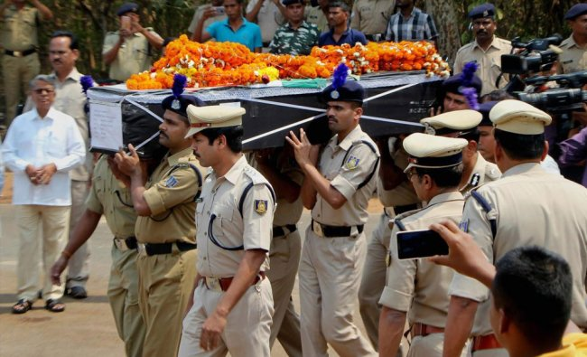 CRPF personnel carry a coffin containing the mortal remains of CRPF constable Manoranjan Lenka...