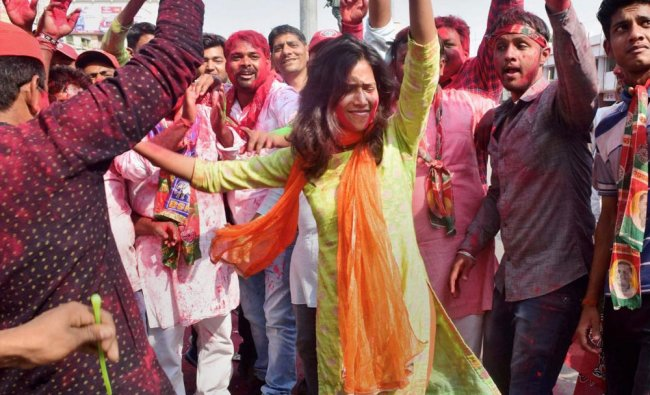 Samajwadi Party supporters celebrate their success in Phulpur and Gorakhpur Lok Sabha by-poll...