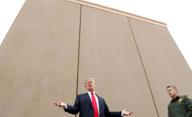 U.S. President Donald Trump speaks while participating in a tour of U.S.-Mexico border wall...