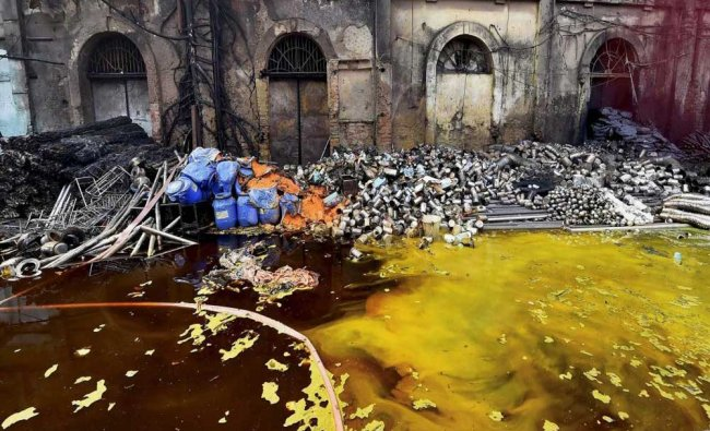 Chemicals spill into water after a fire at chemical warehouse...