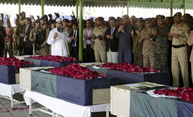 People pray at the funeral for victims of a Wednesday bombing near a police checkpoint...
