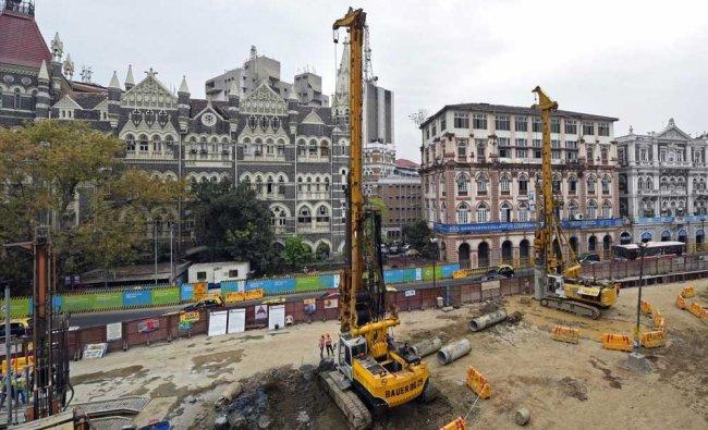 Mumbai Metro employees work at an under construction tunnel site at Colaba-Bandra...
