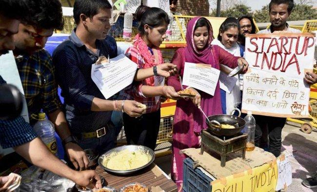 SSC aspirants make pakodas during a \'Pakoda protest\' against alleged paper leak of SSC demanding...