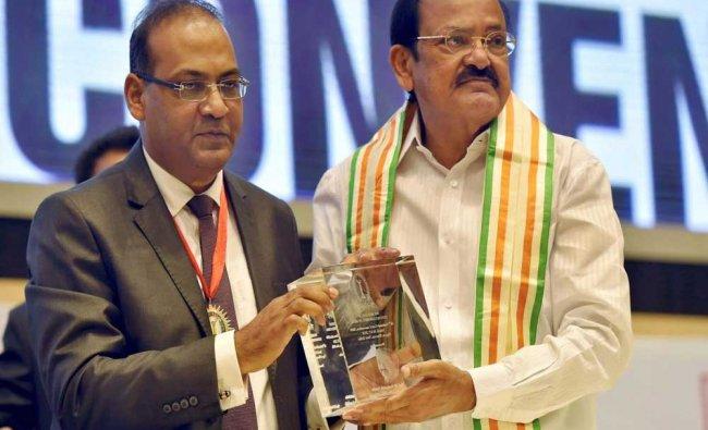 Vice President M Venkaiah Naidu being presented a memento by CMA Sanjay Gupta during...