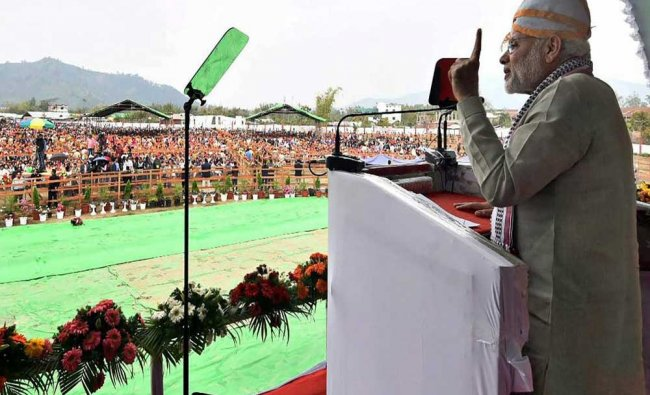 Prime Minister Narendra Modi addresses a gathering during an event to launch development...