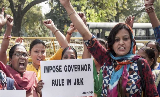 Jammu Kashmir National Panther Party (JKNPP) activists hold placards as they raise slogans...