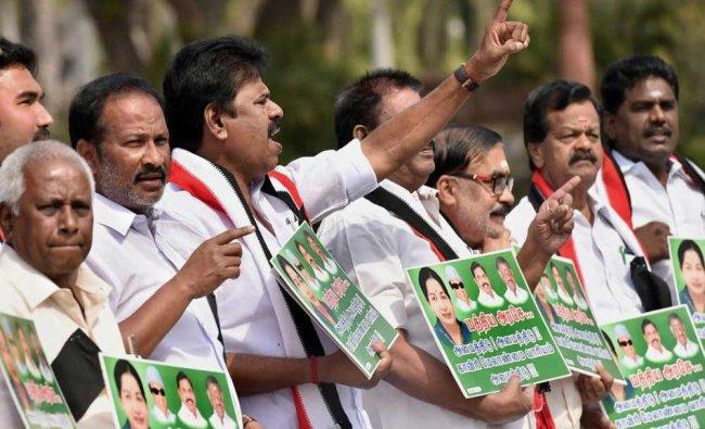 All India Anna Dravida Munnetra Kazhagam (AIADMK) leaders raise slogans demanding constitution...