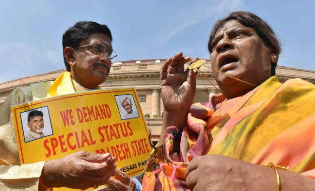 TDP MP Naramalli Siva Prasad dressed as a woman protests demanding special status...