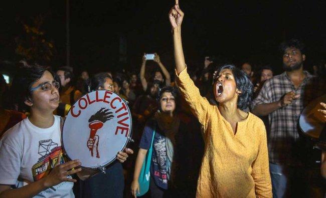 Students of Jawaharlal Nehru University (JNU) protest against JNU professor who is accused ...