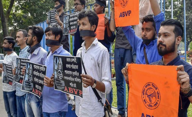 ABVP members participate in a demonstration to protest against spilling of black ink...