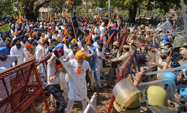 Police personnel lathi charge on the Shiromani Akali Dal (SAD) supporters who were in a bid...