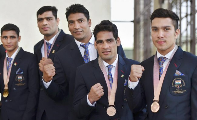 Commonwealth Games 2018, medal winners Indian Army\'s boxers and weightlifter Deepak Lather (R) pose for a photo at Manekshaw Centre in New Delhi on Wednesday. PTI