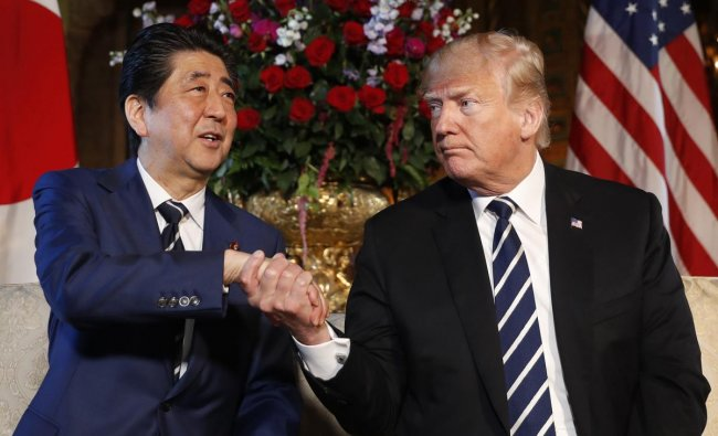 President Donald Trump and Japanese Prime Minister Shinzo Abe shake hands during a meeting at Trump\'s private Mar-a-Lago club, Tuesday, April 17, 2018, in Palm Beach, Florida. AP/PTI