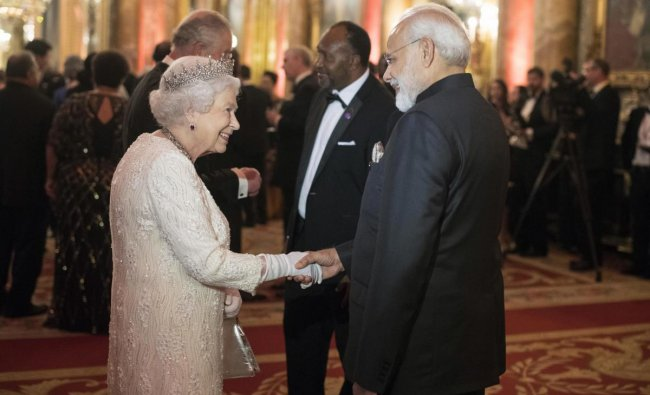 Britain\'s Queen Elizabeth II, greets India\'s Prime Minister Narendra Modi in the Blue Drawing Room at Buckingham Palace as the Queen hosts a dinner during the Commonwealth Heads of Government Meeting, in London, Thursday April 19, 2018. AP/PTI Photo