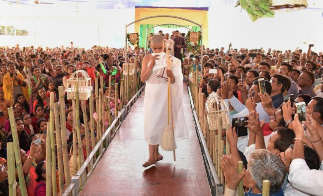 A 12-yr old boy becomes a Jain monk at a ceremony in Surat on Thursday. PTI Photo